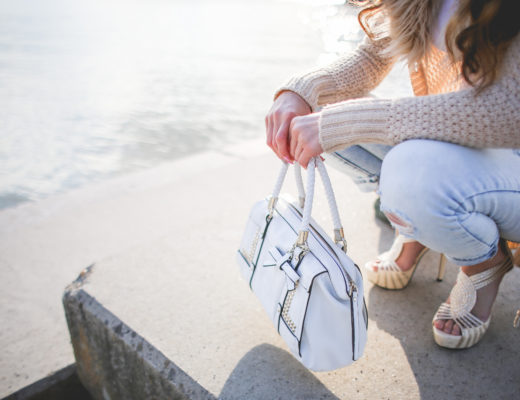 young-woman-with-a-white-handbag-picjumbo-com