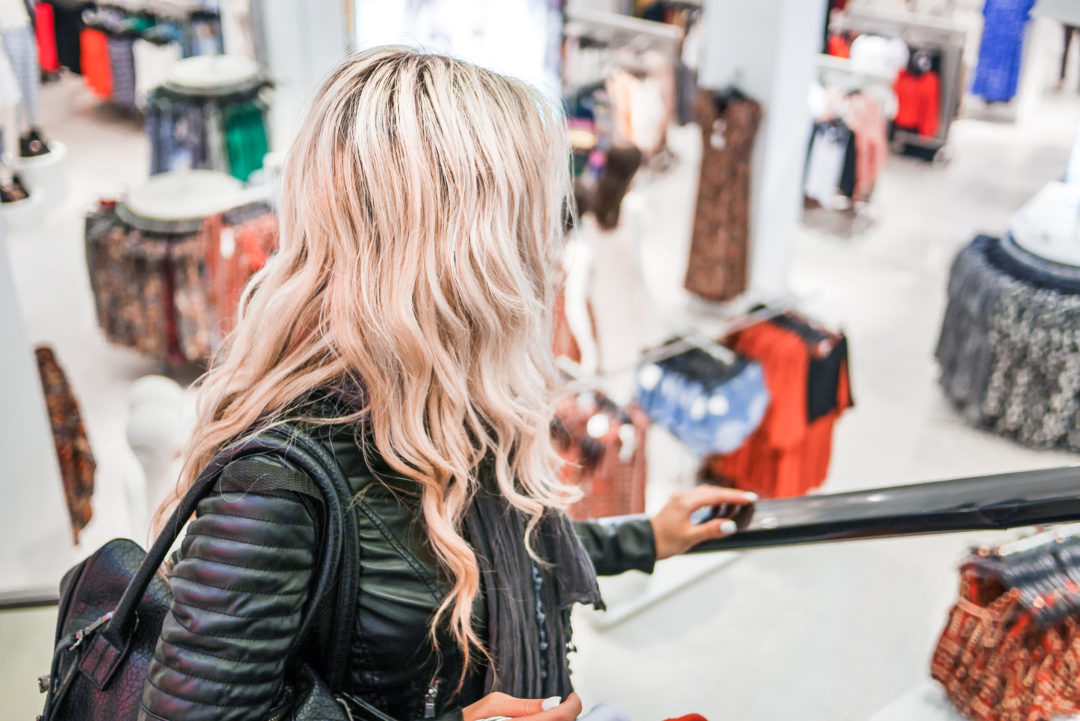 young-blonde-girl-shopping-at-the-clothing-store-picjumbo-com